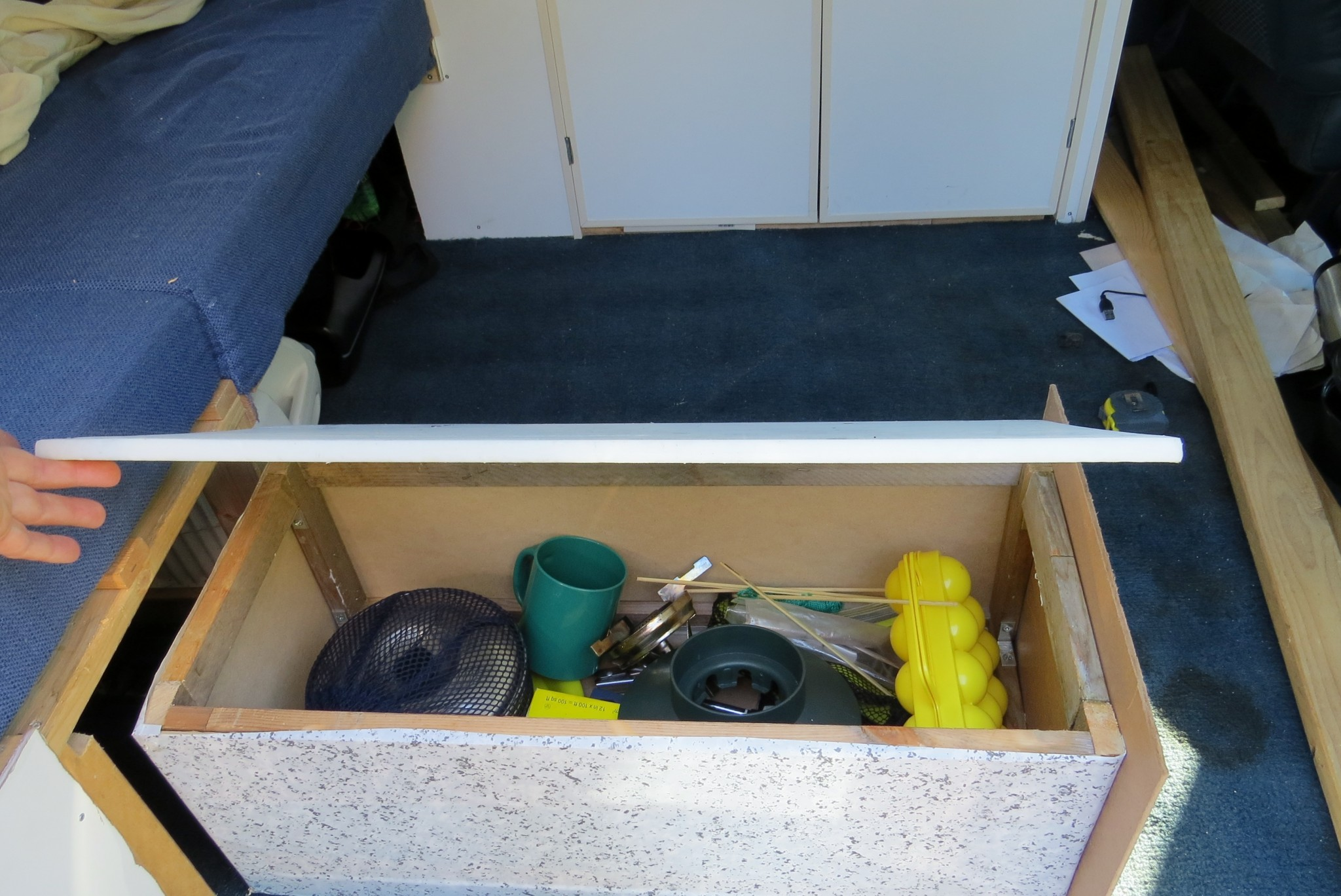 Astro van conversion under seat storage open