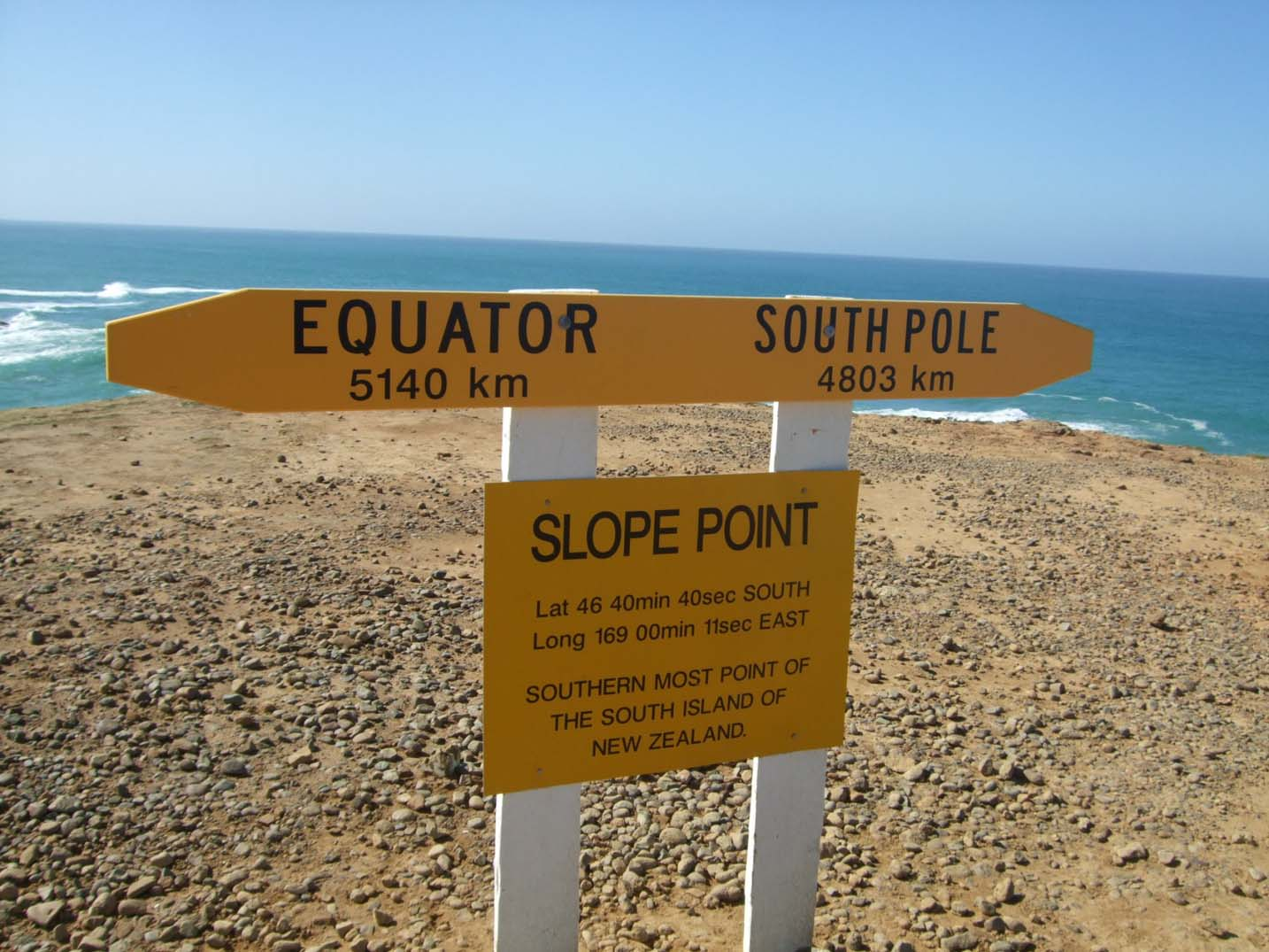 Sign showing distances to Equator and South pole from Slope Point, NZ