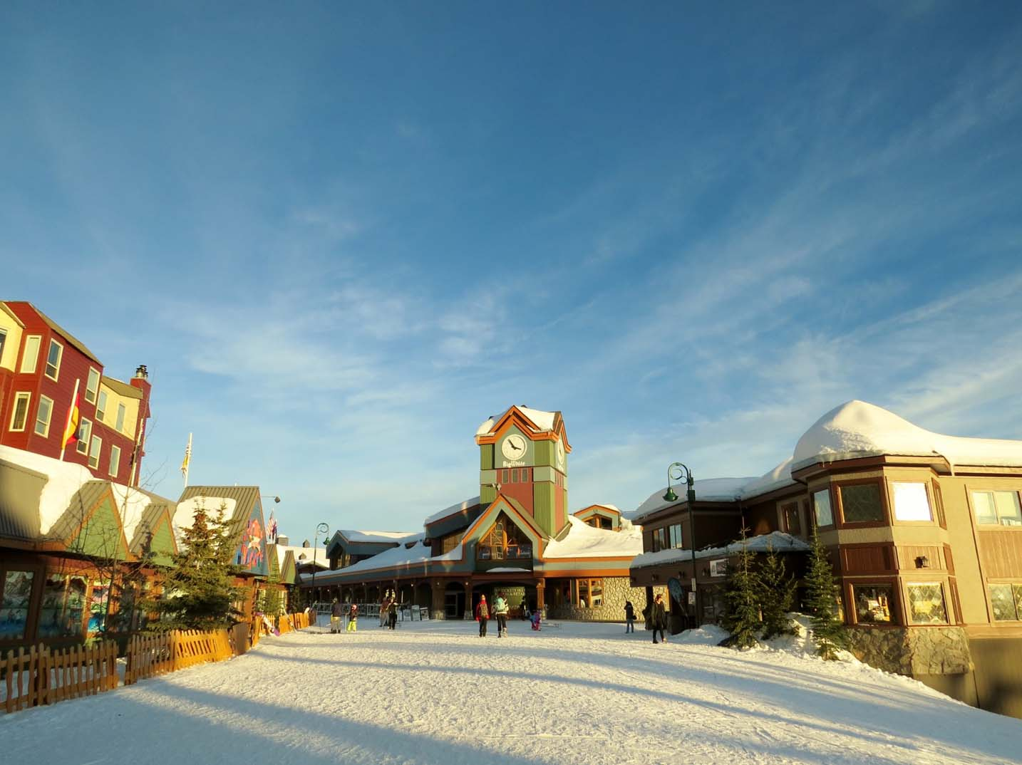 bright coloured buildings with snowy paths at Big White Ski Resort