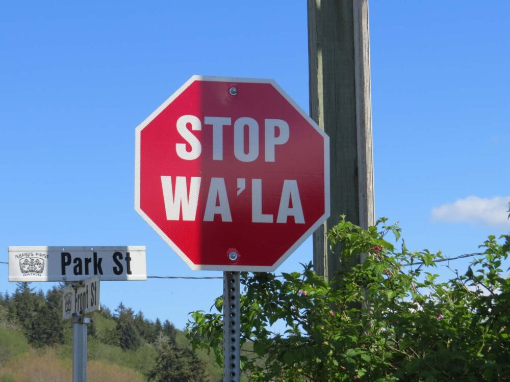 "Stop and ""Wa'la"" on a red sign"