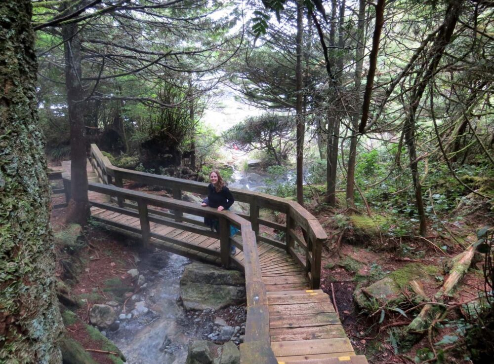 Gemma on boardwalk bridge in forest leading to Hot Springs Cove, Tofino