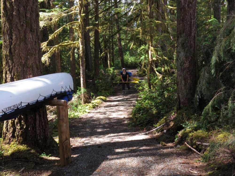 Portaging on the Powell Forest Canoe Circuit, BC