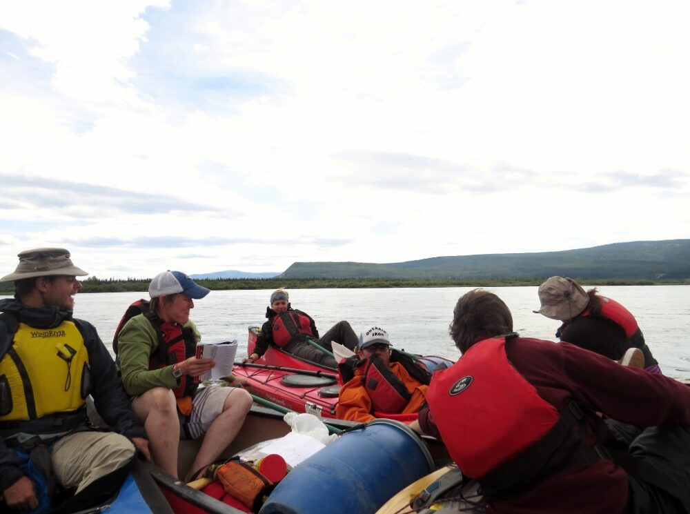 Canoe rafting with fellow paddlers on the Yukon River
