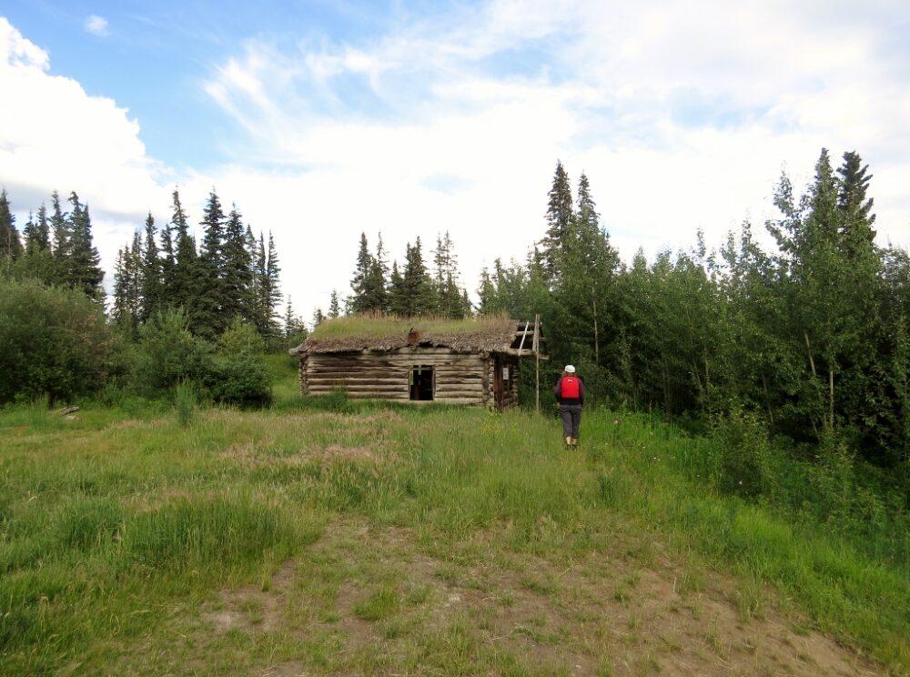 Gemma approaching Big Salmon settlement building