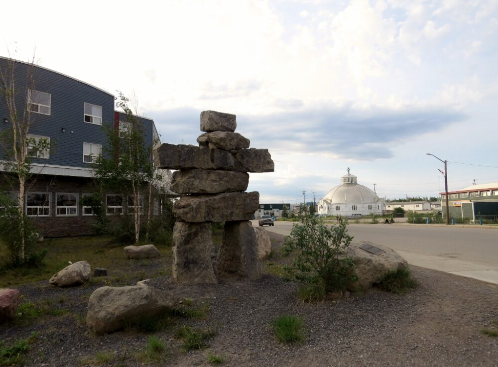 Inukshuk stone structure in front of a hotel in Inuvik, Canada