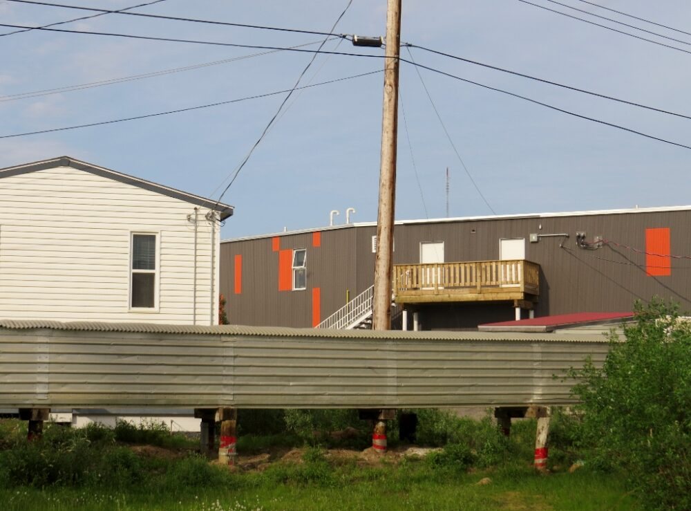 Above ground protection for wiring and plumbing in Inuvik, Canada