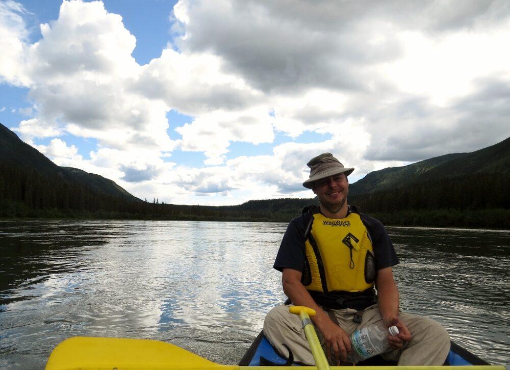 JR sat in canoe on Yukon River