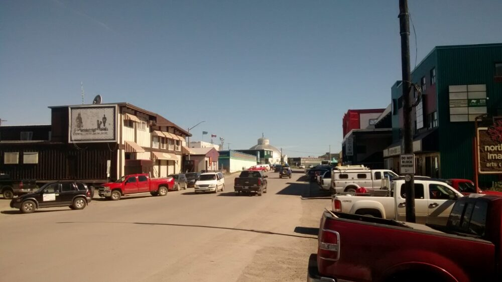 Inuvik's main street with shops and lots of trucks