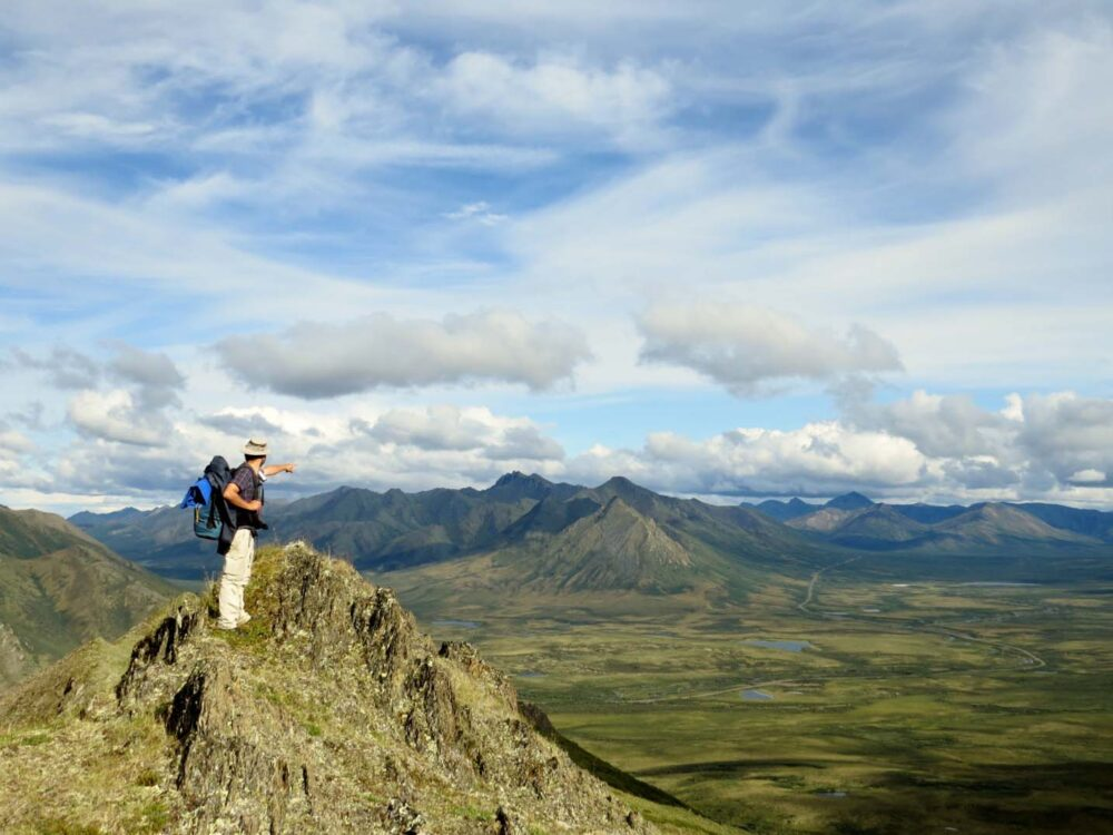 Summiting mountains in Tombstone Territorial Park