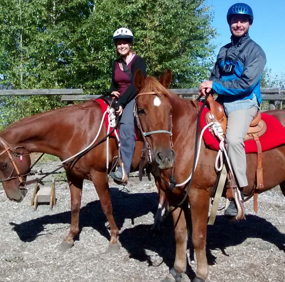Gemma and JR on horses