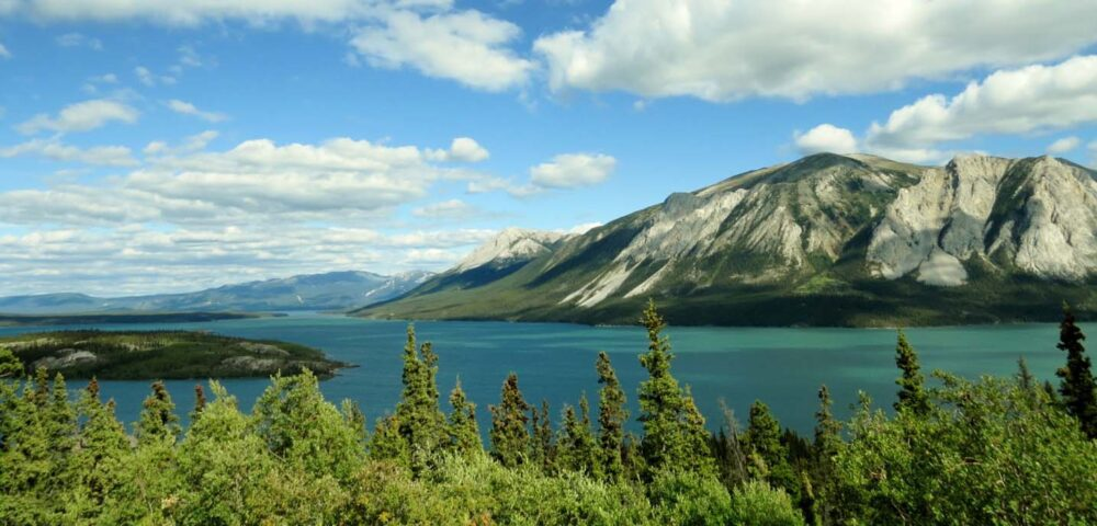 The bright aquamarine waters of Tagish Lake, a roadside attraction in Yukon