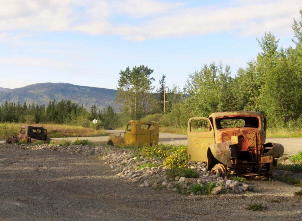 Old cars Alaska Highway Yukon