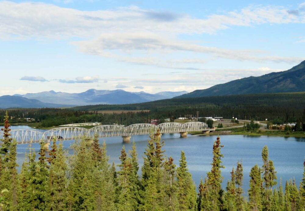 The long Teslin Bridge crossing the calm Teslin River, Yukon Territory - part of the Alaska Highway