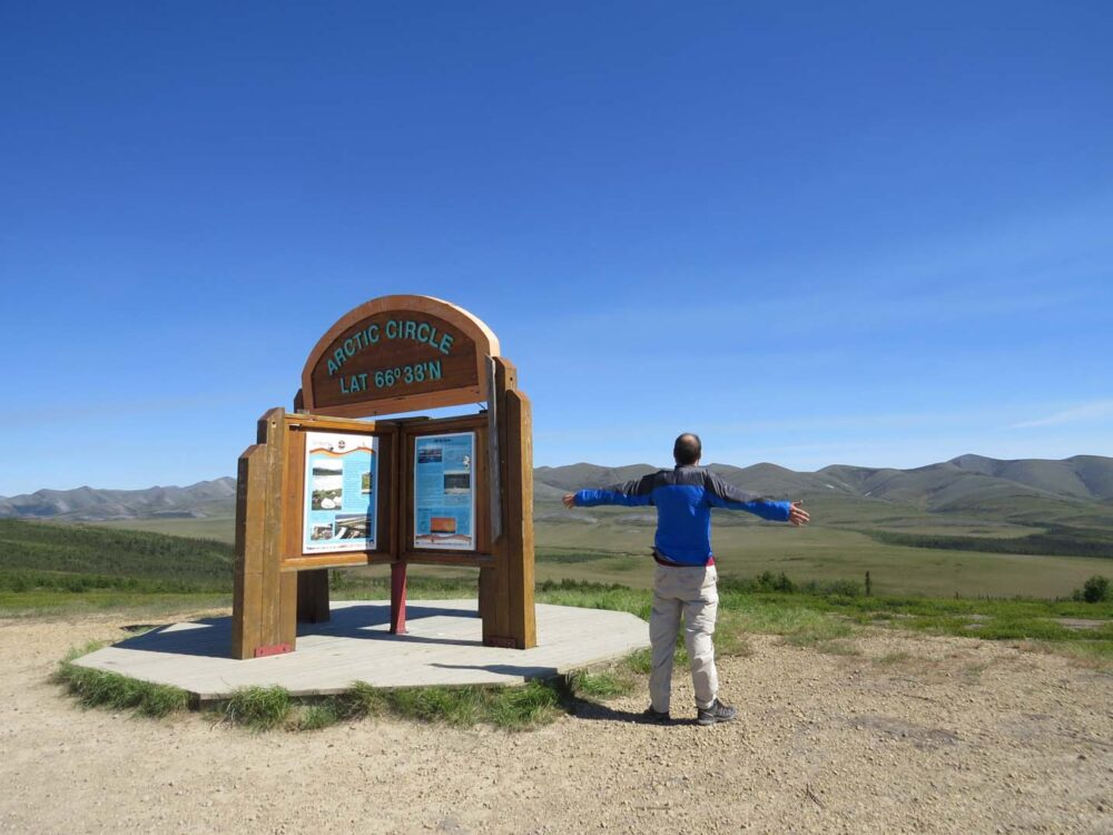 JR looking out past the Arctic Circle sign, Dempster Highway