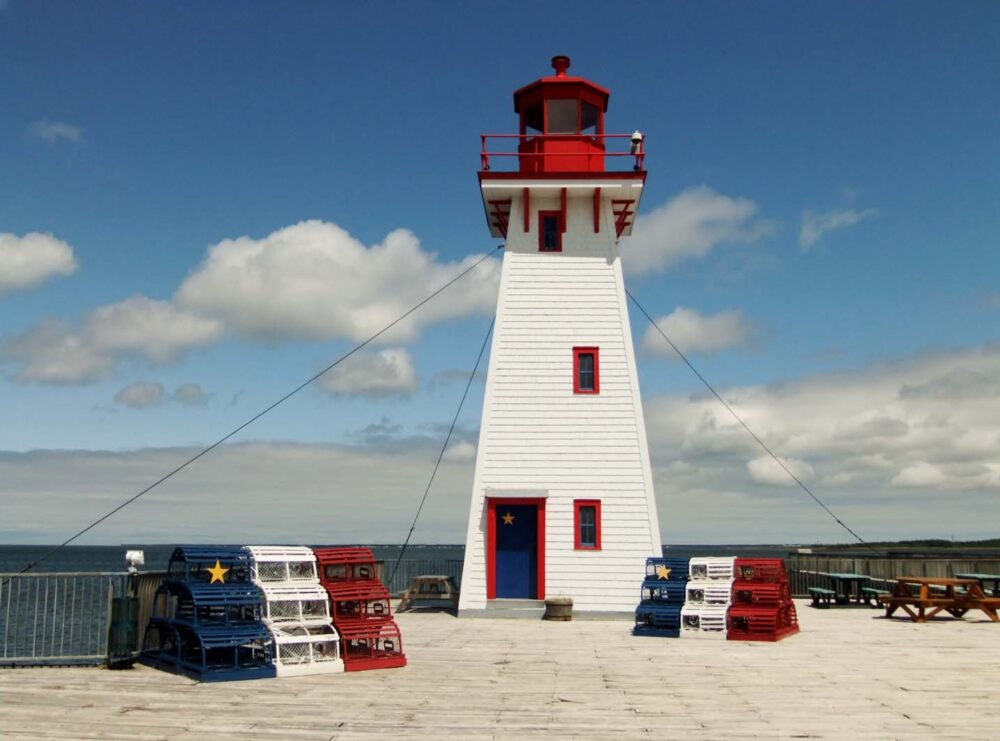 Light house painted in the Acadian flag colors