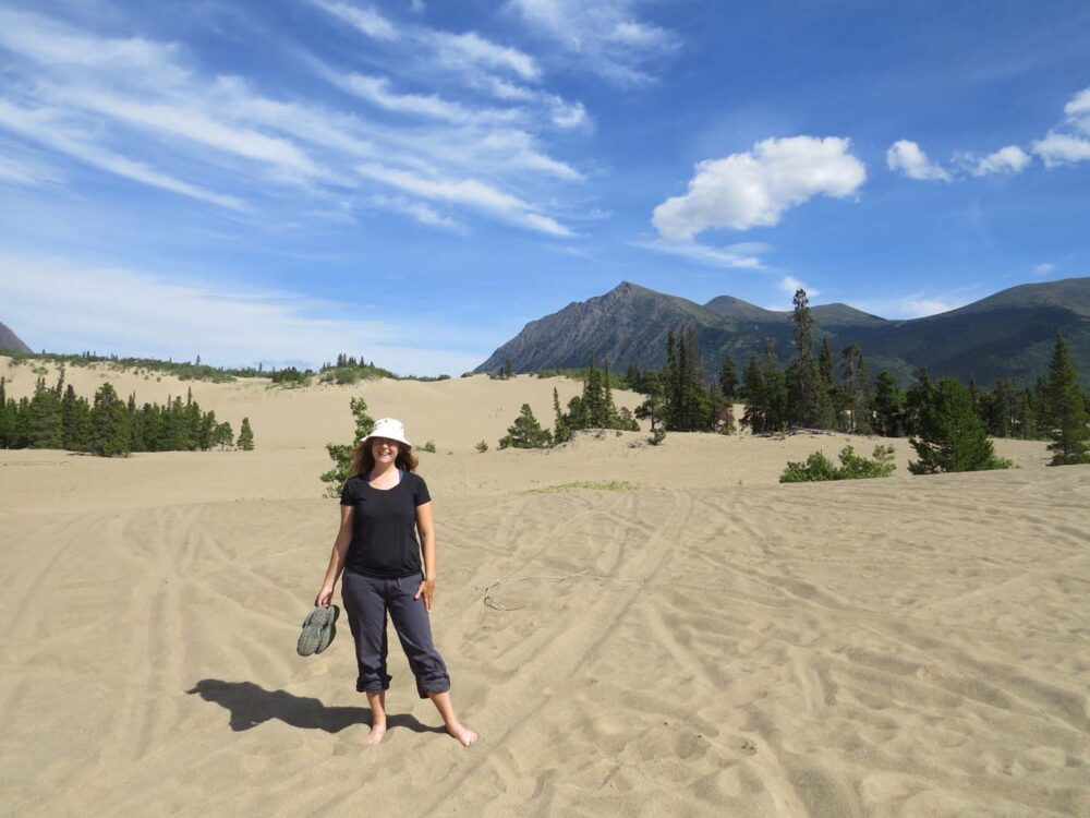 Gemma standing in the stands of the Carcross Desert