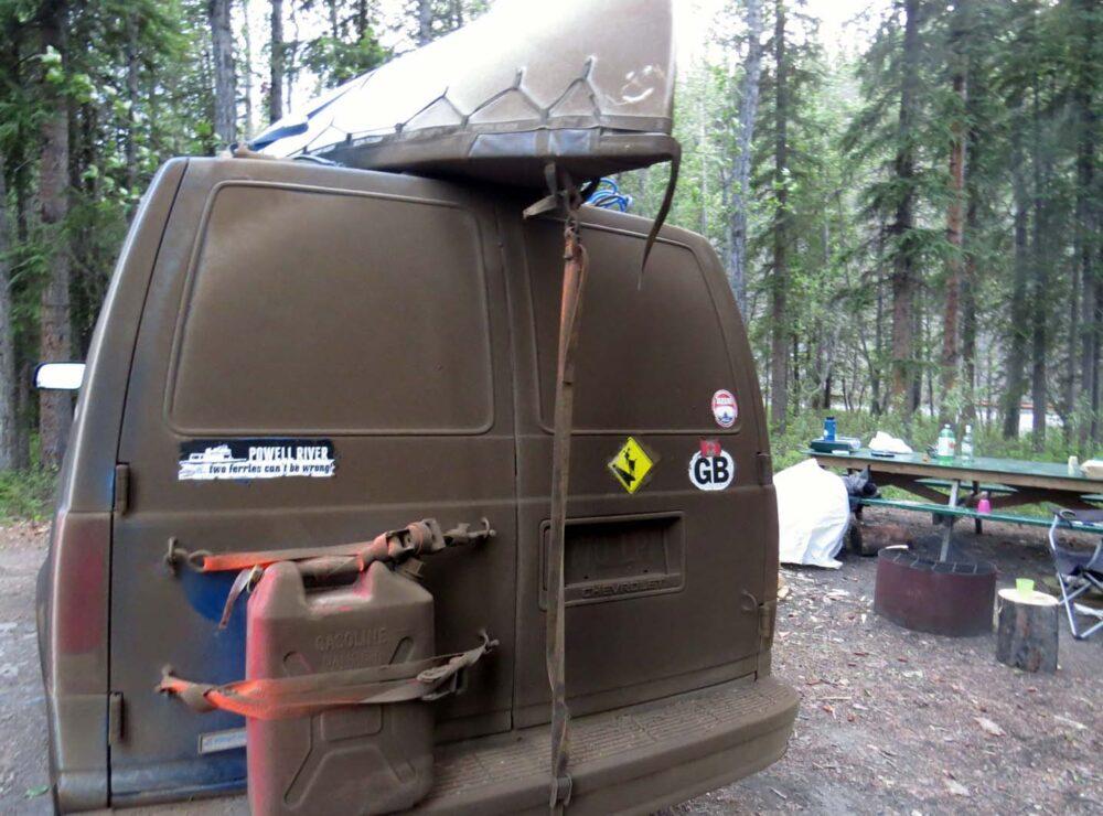 View of back of van caked in mud