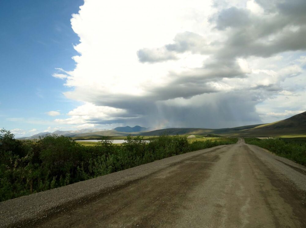 View of rainclouds above the road