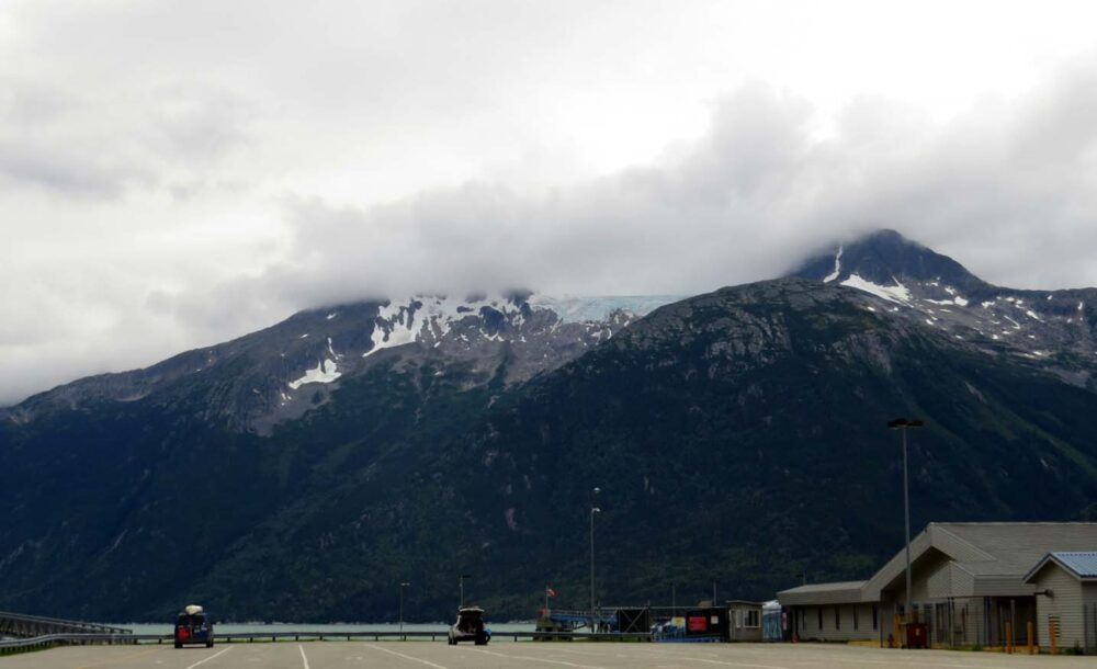 Ferry terminal, backdropped by mountains and glacier