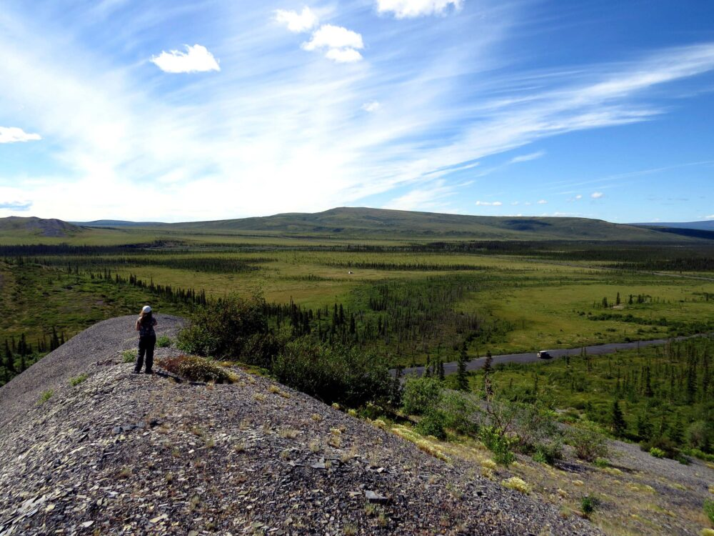 Gemma hiking near the Dempster Highway, with van in distance