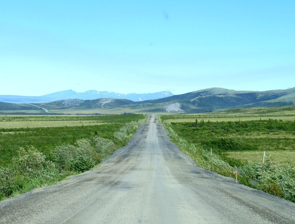 The dirt Dempster Highway stretches into the distance