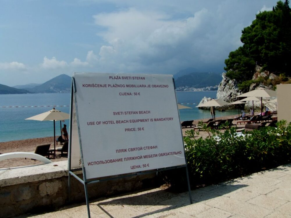 The sign in front of Sveti Stefan beach that states visitors must pay 50 euros for use