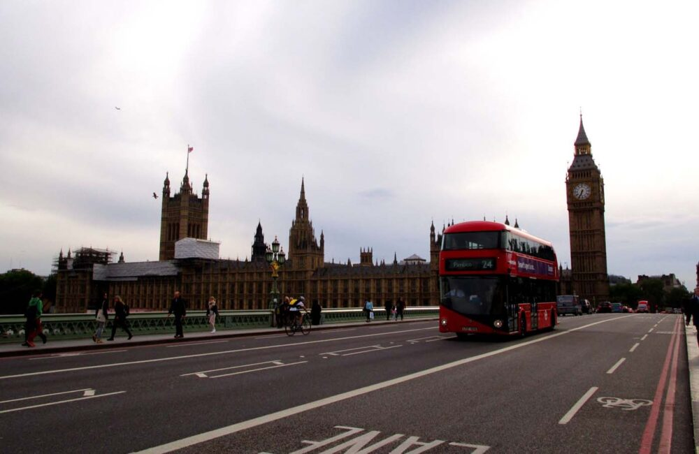 View of Big Ben with double decker red bus in London