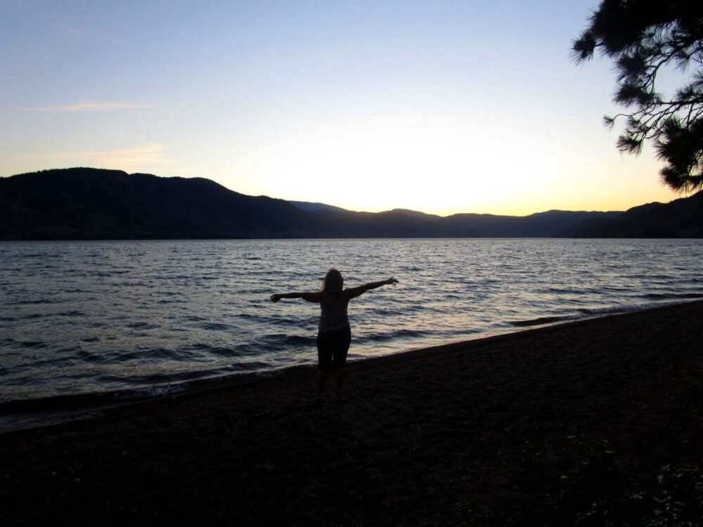 Gemma with arms outstretched, Okanagan Lake