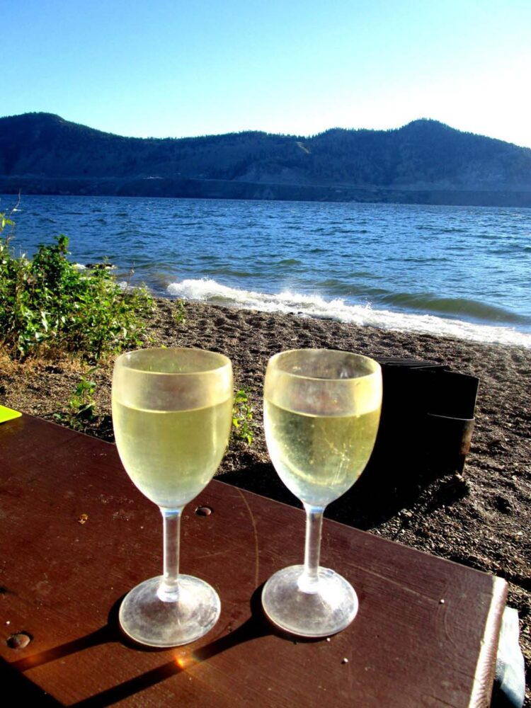 Wine glasses in front of Okanagan Lake