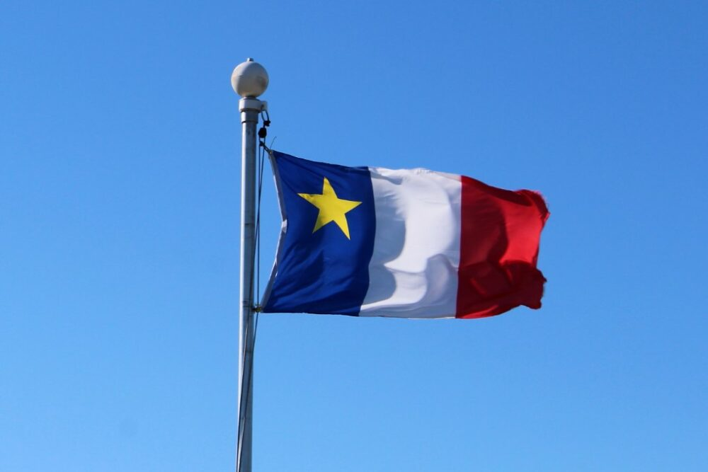 The blue, white and red Acadian flag with yellow star on upper blue portion