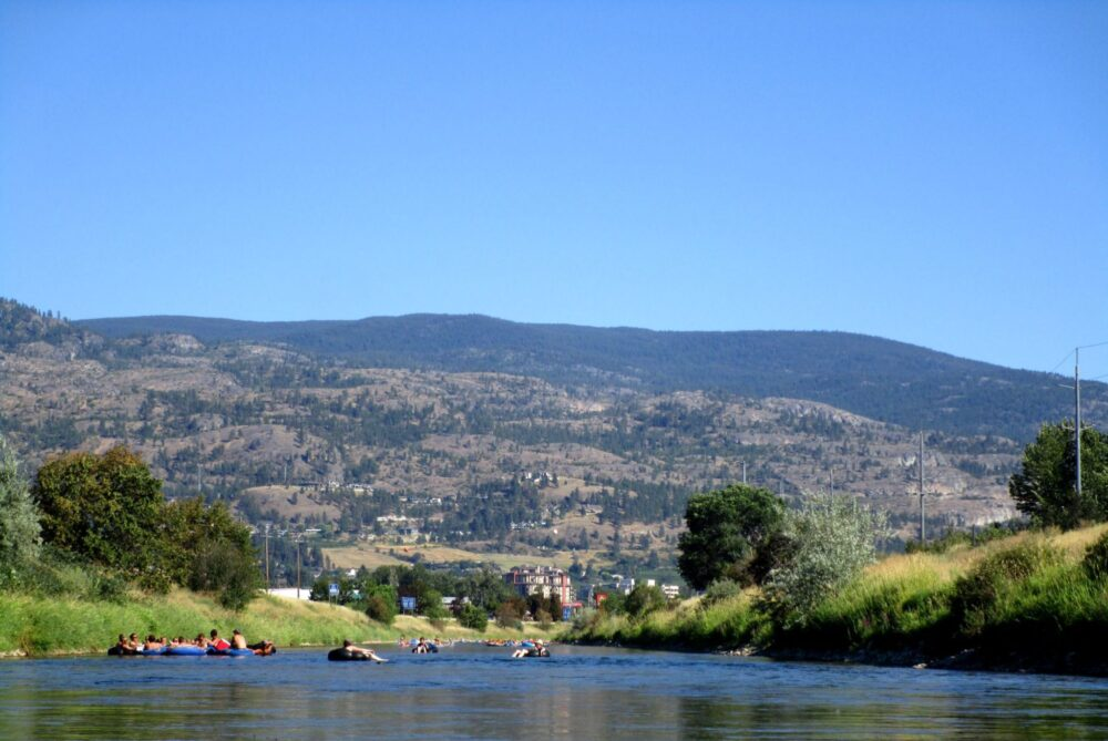 Peoplee floating on inflatable tubes on the Penticton Channel, British Columbia