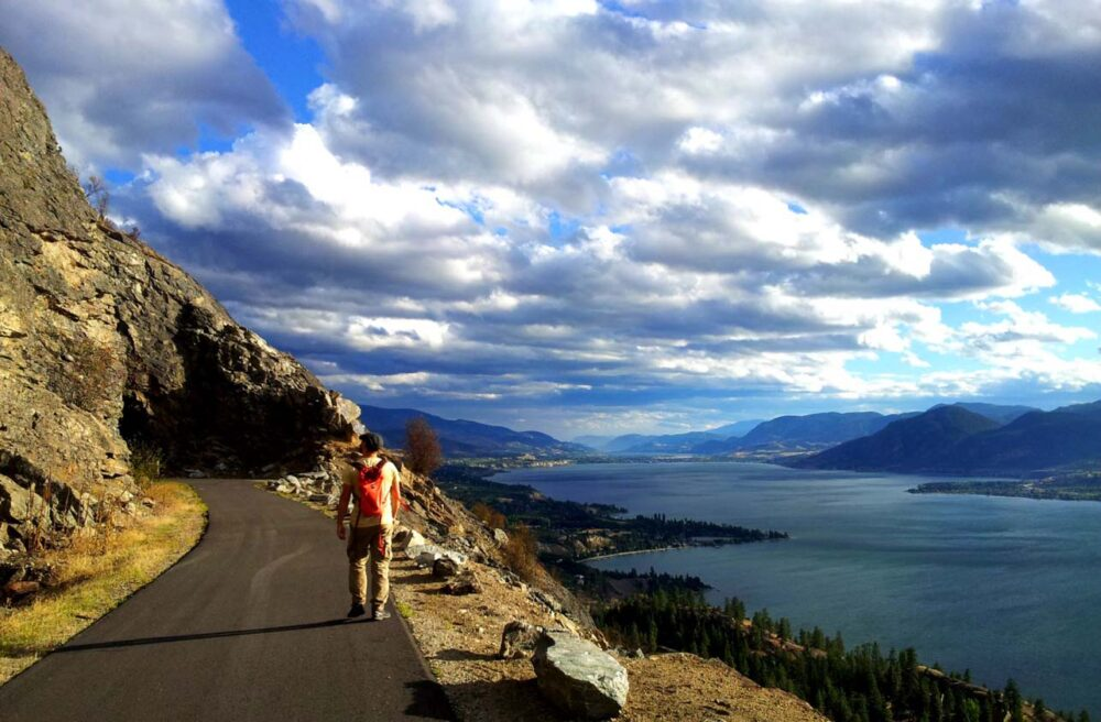 JR walking towards tunnel with views of Okanagan Lake