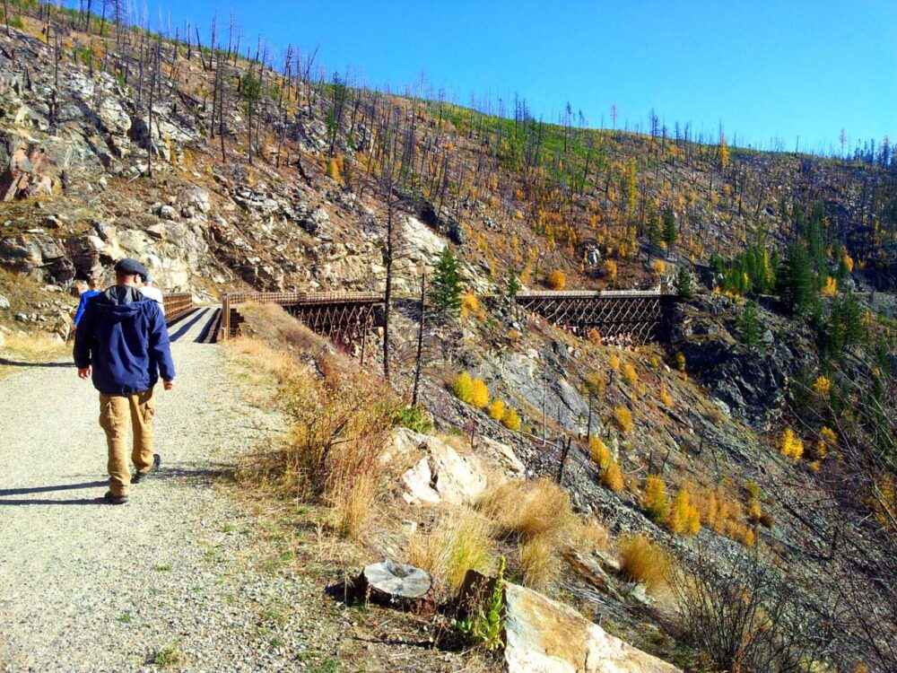 JR walking towards Myra Canyon trestle near Kelowna