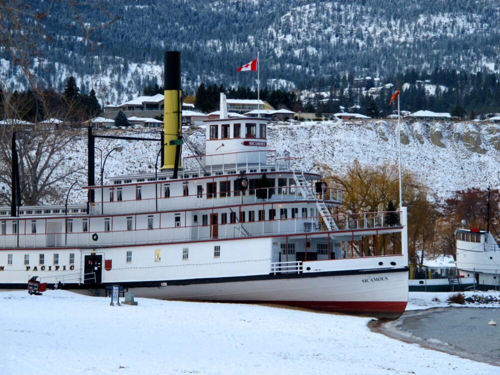 Sicamous paddle boat on snowy Okanagan Lake beach