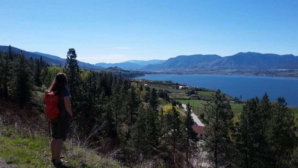 Gemma looking out towards views of Okanagan lake on the KVR Trail