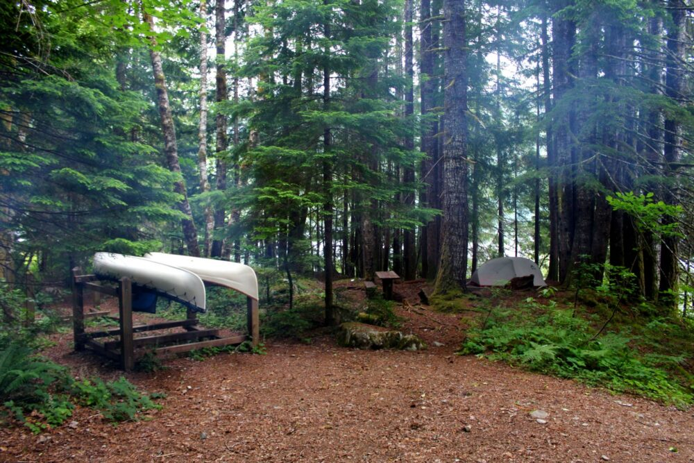 Canoe racks and campsite at Della Falls trail campground