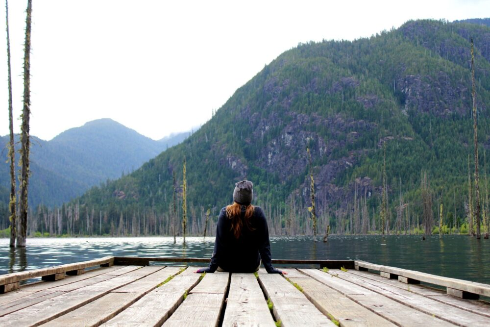 Gemma sitting on the Great Central lake dock at the Della Falls trailhead