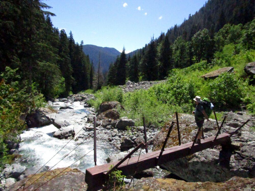 JR crossing a bridge over a river, Della Falls trail