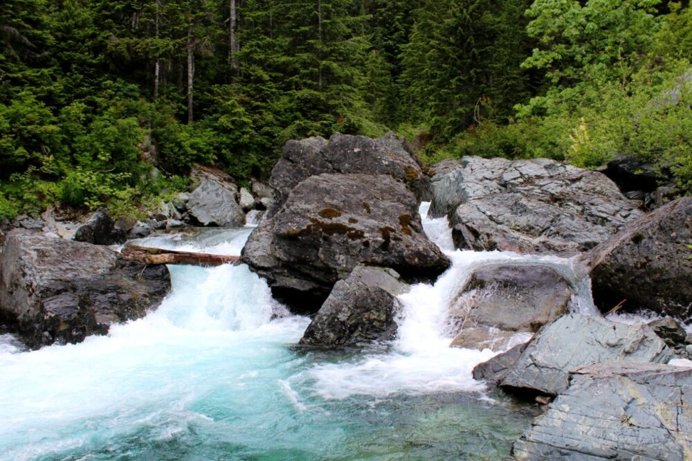 A waterfall on turquoise Drinkwater Creek with huge boulders