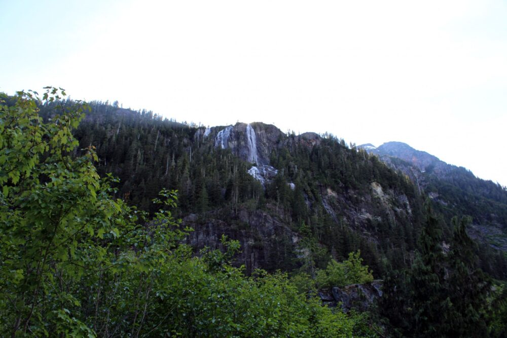 A distance view of Della Falls cascading down the mountain