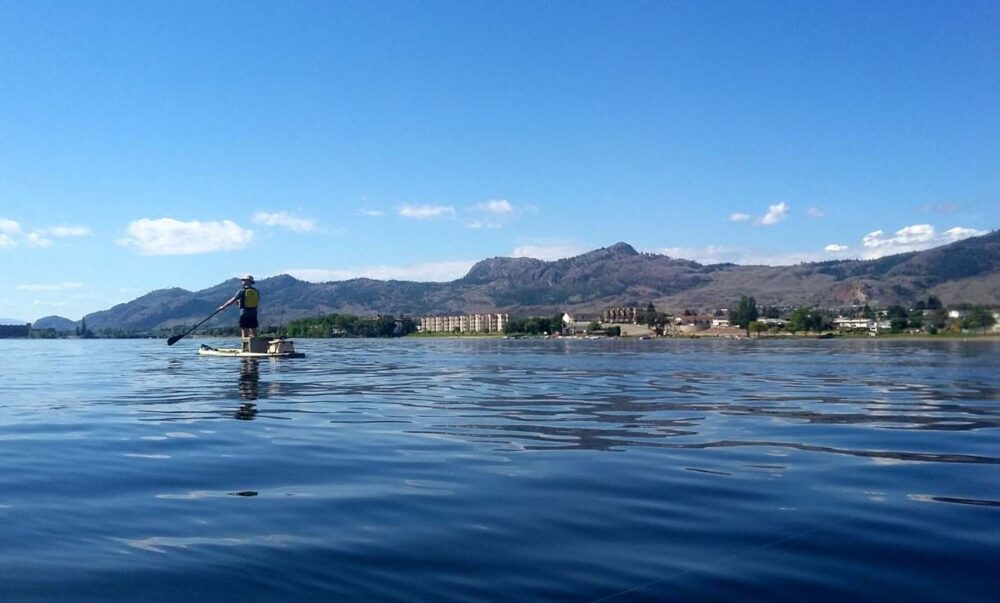 Jr standing on a paddle board on Osoyoos Lake
