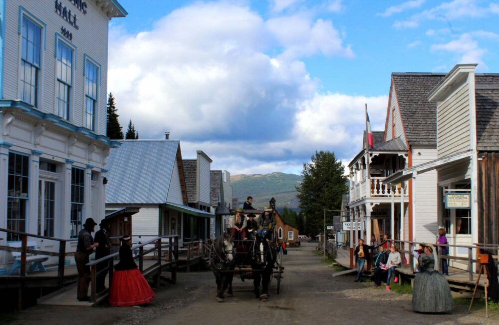 Horse drawn cart travelling down Barkerville's main street