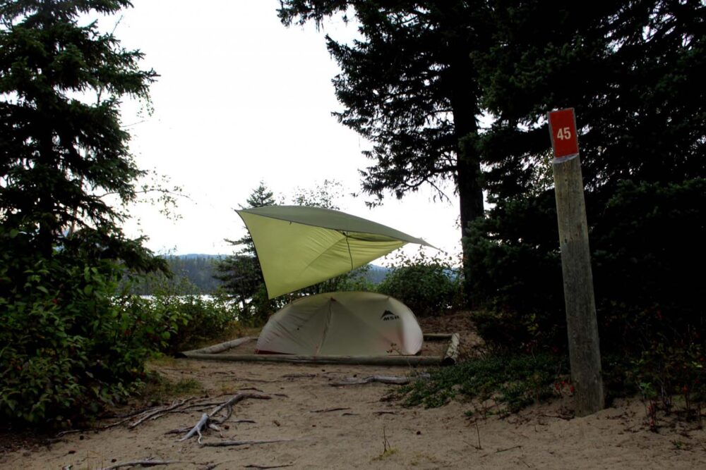 Tent and tarp at campsite 45 on the Bowron Lakes Canoe Circuit