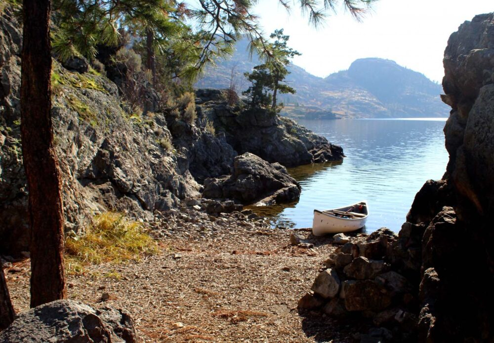 7 Canadian canoe trips you must do - canoe in beach on Okanagan Lake