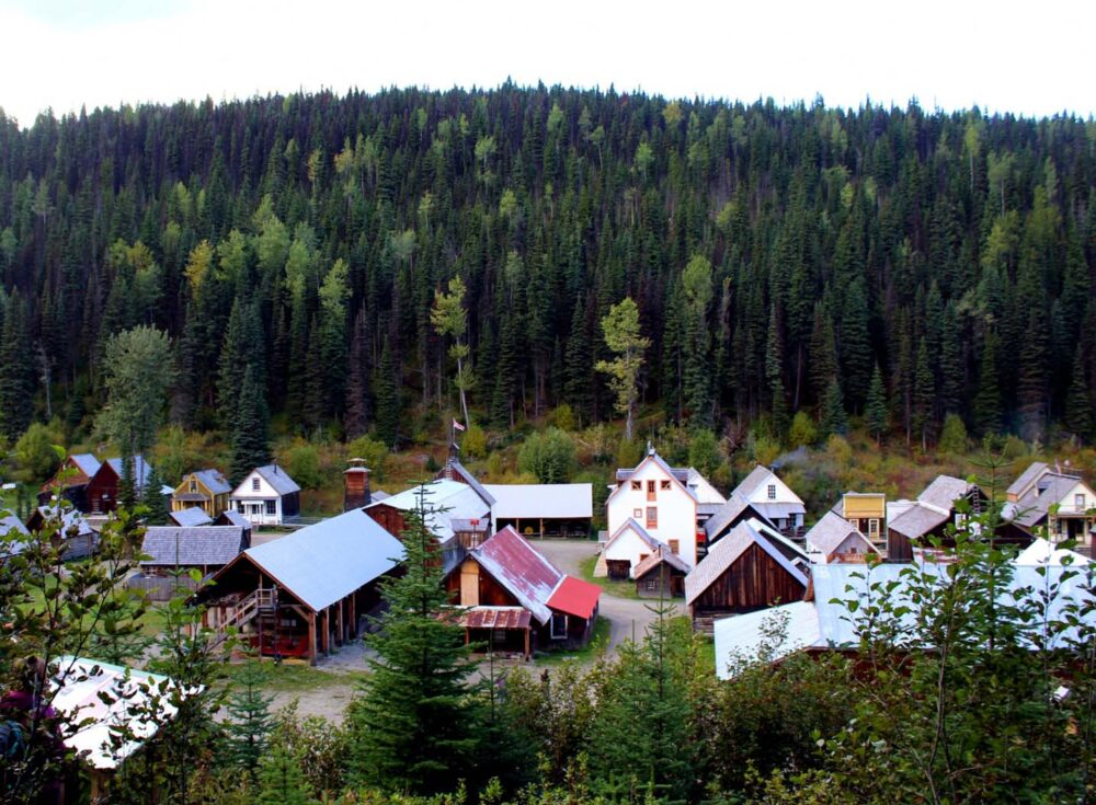 Elevated view of Barkerville's wooden houses and shops surrounded by forest