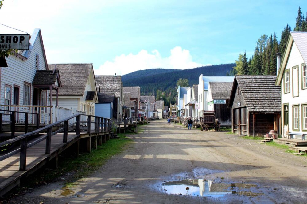 Barkerville's Main Street with large puddle on dirt road