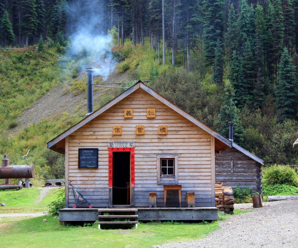 The Chinese School is a small wooden building with a smoky chimney