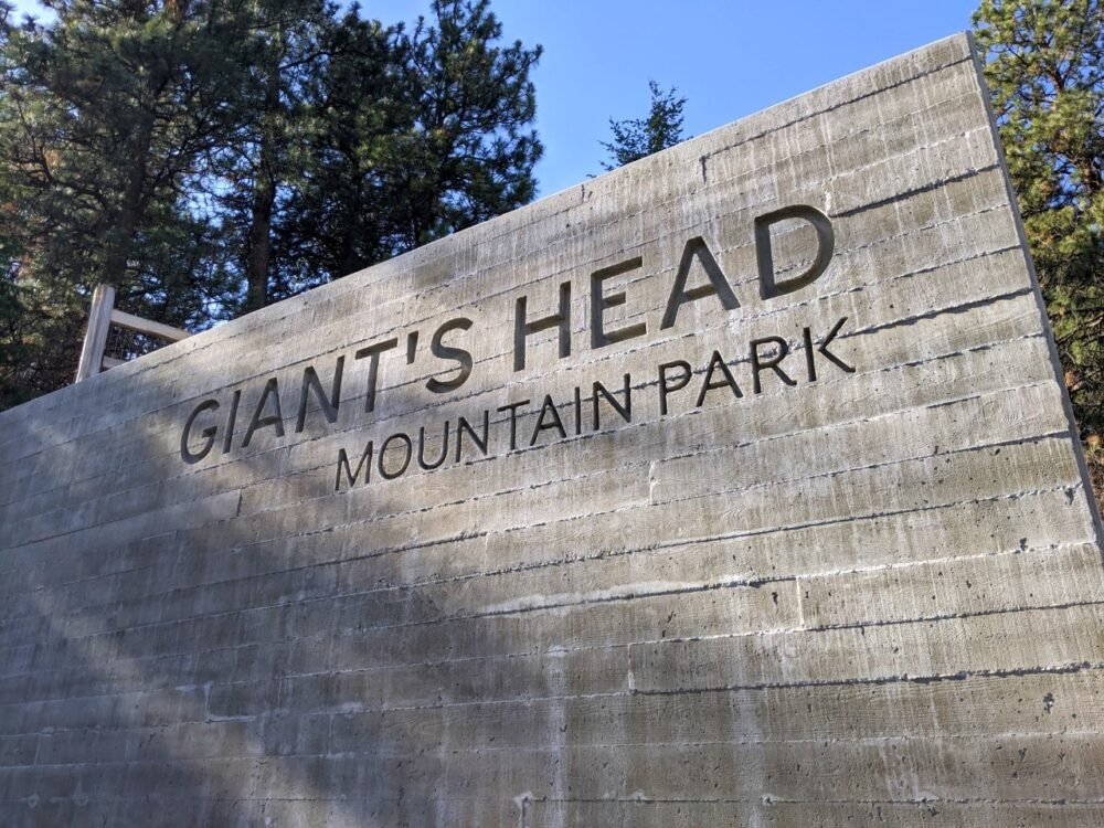 A rock sign with carved 'Giant's Head Mountain Park'