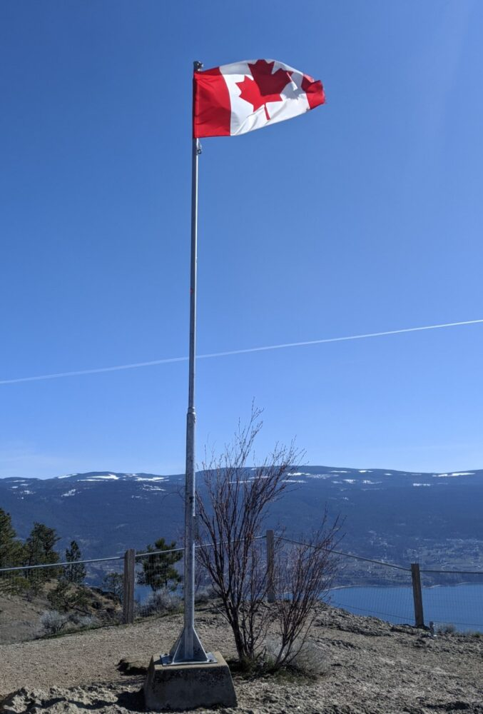 Flying Canadian flag on post at the top of Giant's Head Mountain