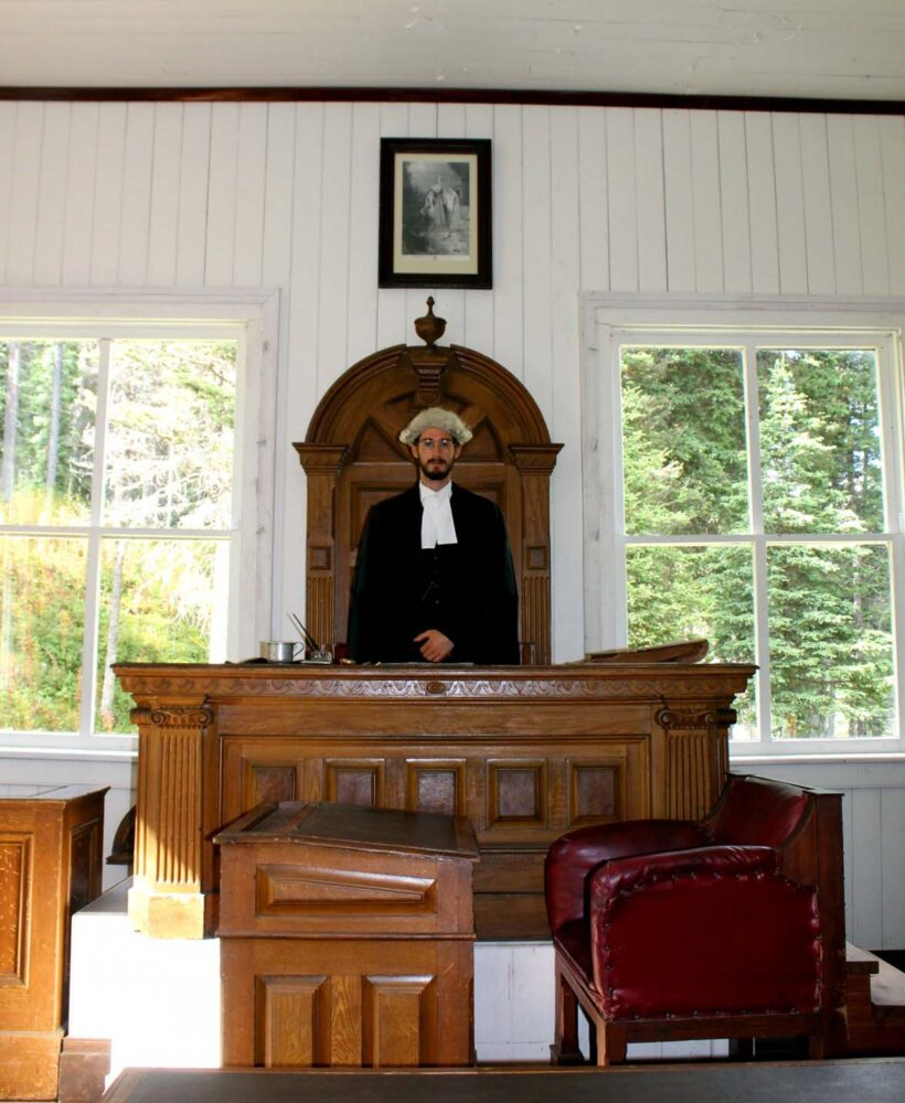 A judge sits behind the Bench in the Richfield Courthouse, Barkerville